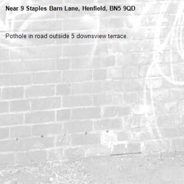 Pothole in road outside 5 downsview terrace. -9 Staples Barn Lane, Henfield, BN5 9QD