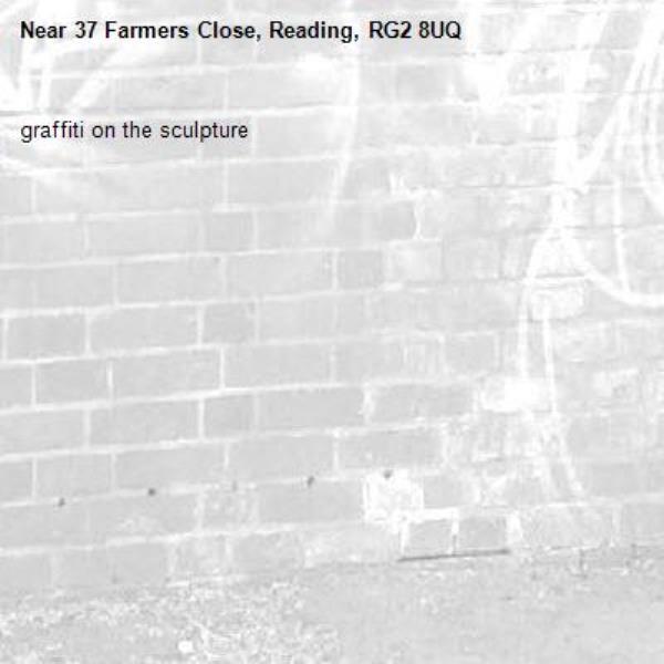 graffiti on the sculpture -37 Farmers Close, Reading, RG2 8UQ