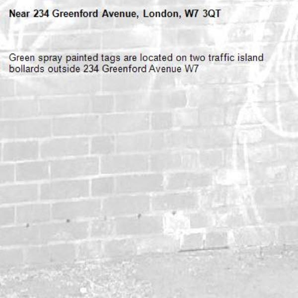 Green spray painted tags are located on two traffic island bollards outside 234 Greenford Avenue W7 -234 Greenford Avenue, London, W7 3QT