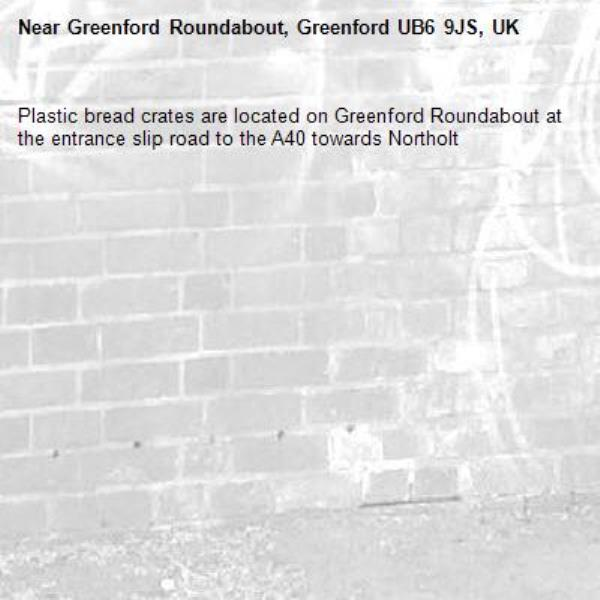 Plastic bread crates are located on Greenford Roundabout at the entrance slip road to the A40 towards Northolt -Greenford Roundabout, Greenford UB6 9JS, UK