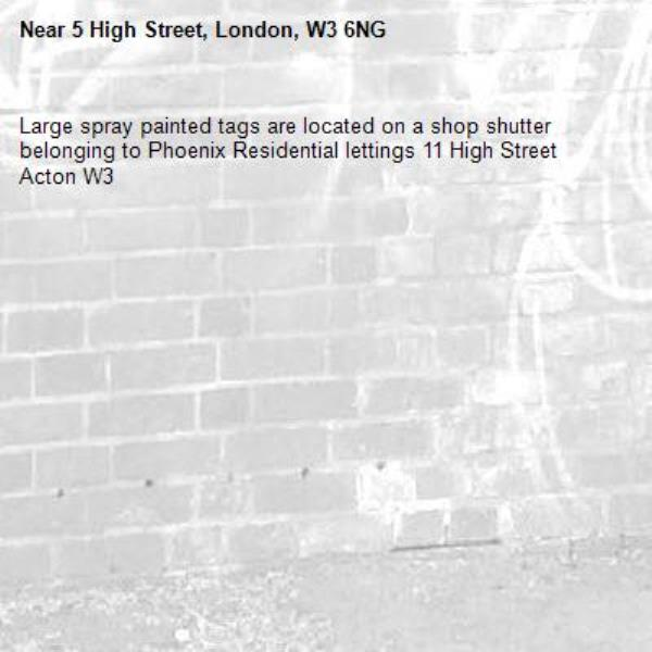 Large spray painted tags are located on a shop shutter belonging to Phoenix Residential lettings 11 High Street Acton W3 -5 High Street, London, W3 6NG