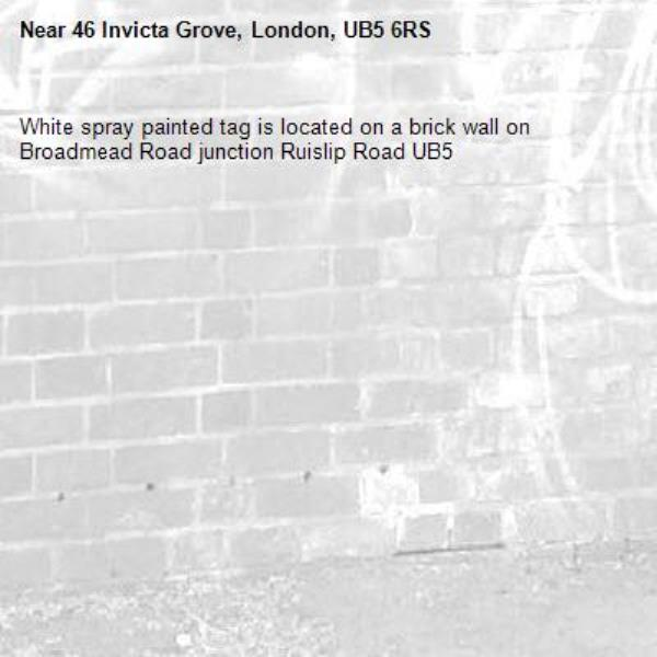 White spray painted tag is located on a brick wall on Broadmead Road junction Ruislip Road UB5 -46 Invicta Grove, London, UB5 6RS