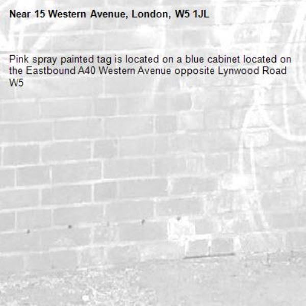 Pink spray painted tag is located on a blue cabinet located on the Eastbound A40 Western Avenue opposite Lynwood Road W5 -15 Western Avenue, London, W5 1JL