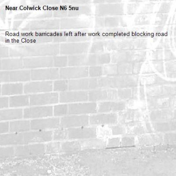 Road work barricades left after work completed blocking road in the Close-Colwick Close N6 5nu