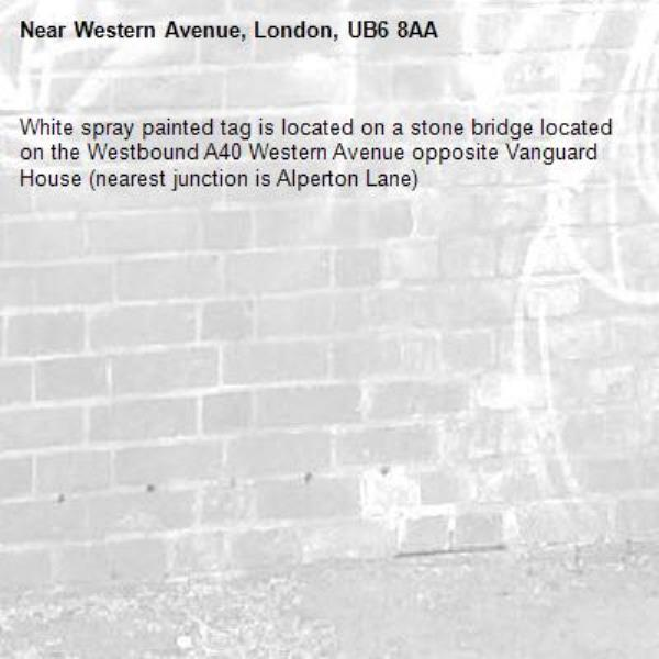 White spray painted tag is located on a stone bridge located on the Westbound A40 Western Avenue opposite Vanguard House (nearest junction is Alperton Lane) -Western Avenue, London, UB6 8AA