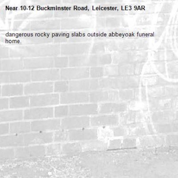 dangerous rocky paving slabs outside abbeyoak funeral home.-10-12 Buckminster Road, Leicester, LE3 9AR
