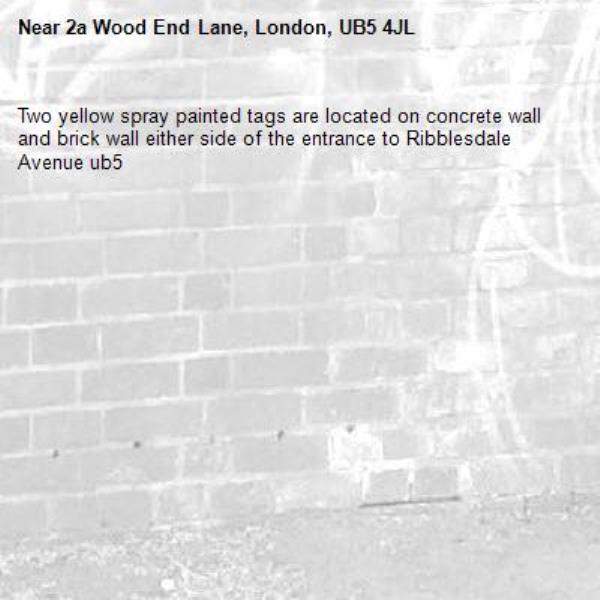 Two yellow spray painted tags are located on concrete wall and brick wall either side of the entrance to Ribblesdale Avenue ub5-2a Wood End Lane, London, UB5 4JL