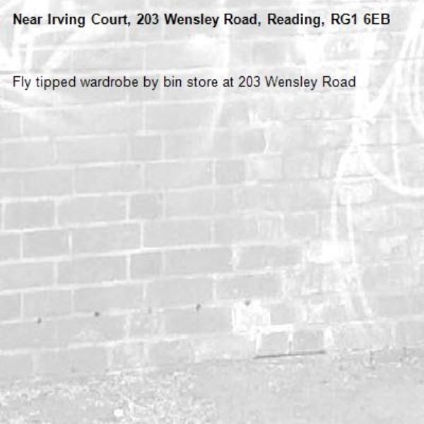 Fly tipped wardrobe by bin store at 203 Wensley Road  -Irving Court, 203 Wensley Road, Reading, RG1 6EB