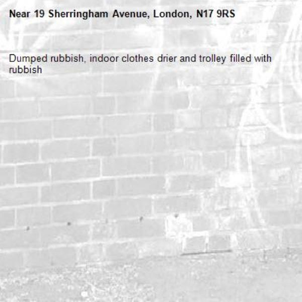 Dumped rubbish, indoor clothes drier and trolley filled with rubbish -19 Sherringham Avenue, London, N17 9RS