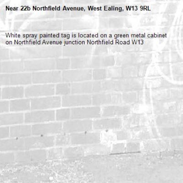 White spray painted tag is located on a green metal cabinet on Northfield Avenue junction Northfield Road W13-22b Northfield Avenue, West Ealing, W13 9RL