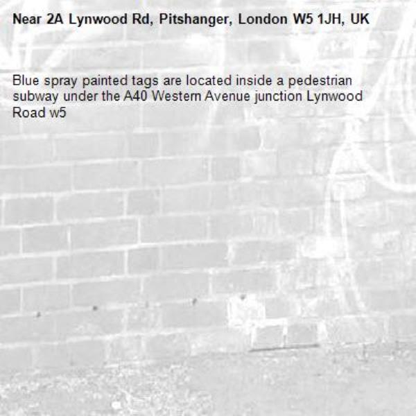 Blue spray painted tags are located inside a pedestrian subway under the A40 Western Avenue junction Lynwood Road w5-2A Lynwood Rd, Pitshanger, London W5 1JH, UK