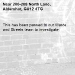 This has been passed to our Waste and Streets team to investigate -206-208 North Lane, Aldershot, GU12 4TG