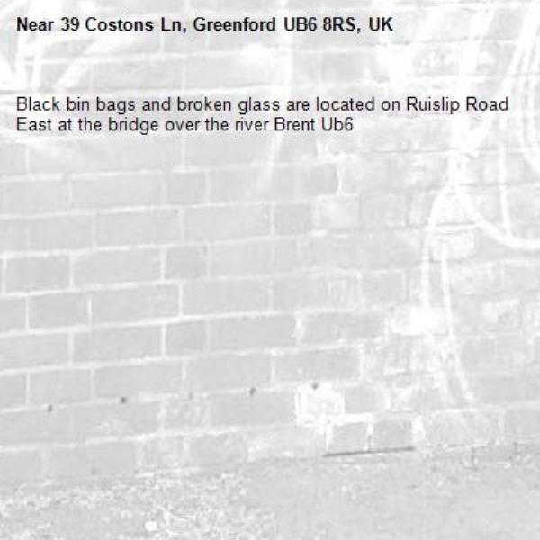 Black bin bags and broken glass are located on Ruislip Road East at the bridge over the river Brent Ub6 -39 Costons Ln, Greenford UB6 8RS, UK