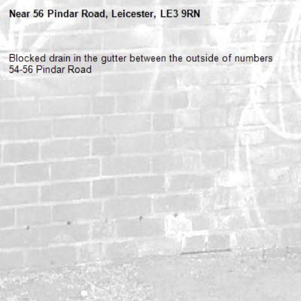 Blocked drain in the gutter between the outside of numbers 54-56 Pindar Road-56 Pindar Road, Leicester, LE3 9RN
