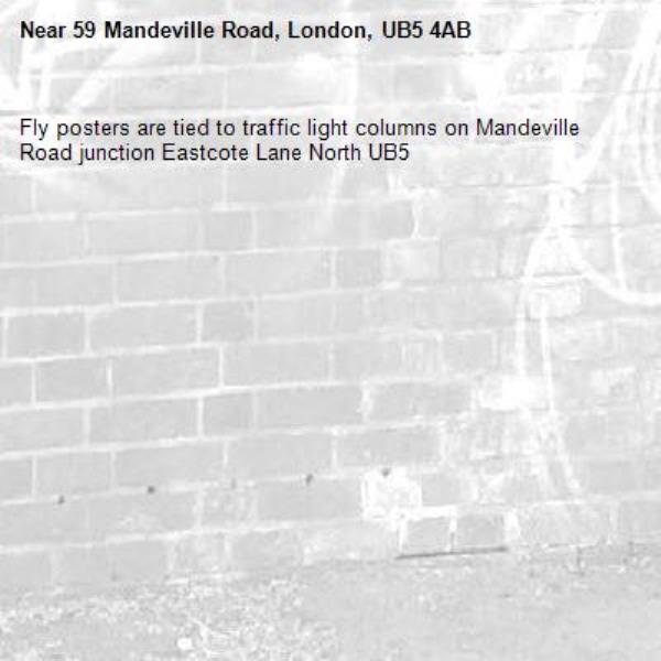Fly posters are tied to traffic light columns on Mandeville Road junction Eastcote Lane North UB5 -59 Mandeville Road, London, UB5 4AB