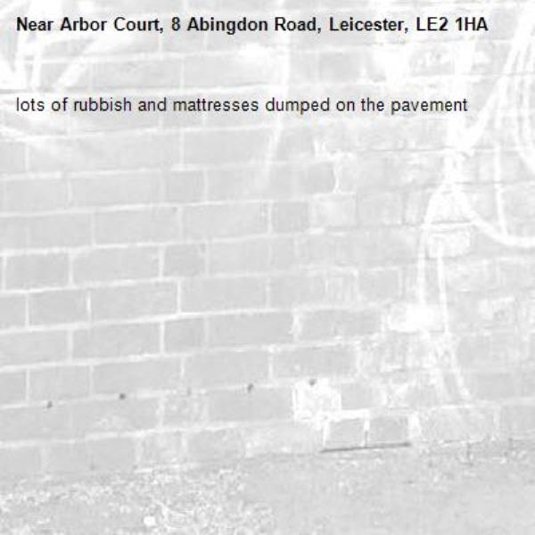 lots of rubbish and mattresses dumped on the pavement -Arbor Court, 8 Abingdon Road, Leicester, LE2 1HA