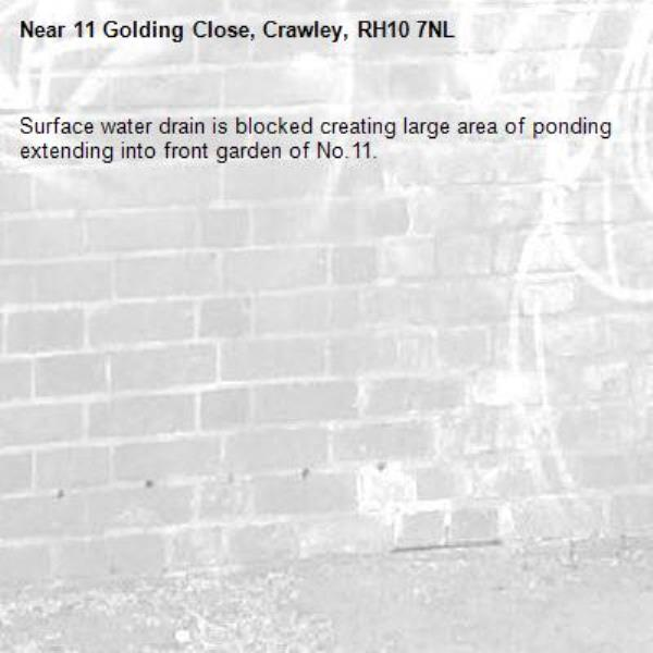 Surface water drain is blocked creating large area of ponding extending into front garden of No.11. -11 Golding Close, Crawley, RH10 7NL