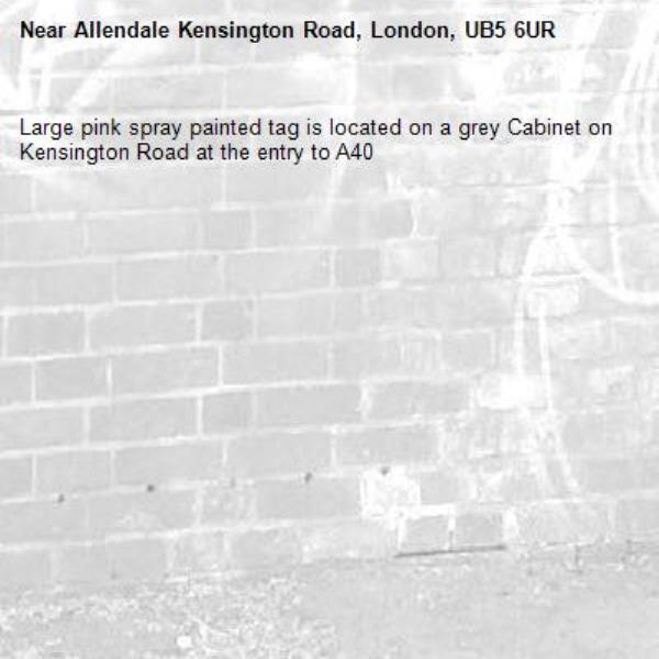 Large pink spray painted tag is located on a grey Cabinet on Kensington Road at the entry to A40 -Allendale Kensington Road, London, UB5 6UR