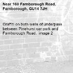 Graffiti on both walls of underpass between Pinehurst car park and Farnborough Road.  image 2-160 Farnborough Road, Farnborough, GU14 7JH