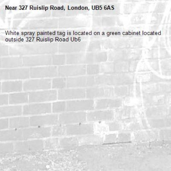 White spray painted tag is located on a green cabinet located outside 327 Ruislip Road Ub6 -327 Ruislip Road, London, UB5 6AS