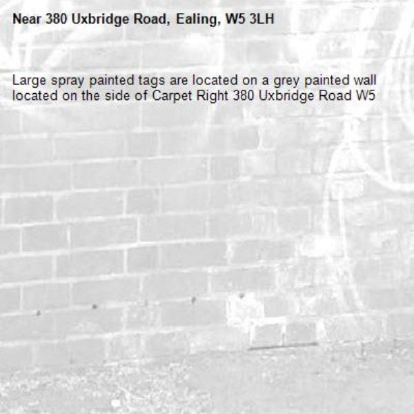 Large spray painted tags are located on a grey painted wall located on the side of Carpet Right 380 Uxbridge Road W5-380 Uxbridge Road, Ealing, W5 3LH