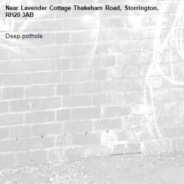 Deep pothole -Lavender Cottage Thakeham Road, Storrington, RH20 3AB