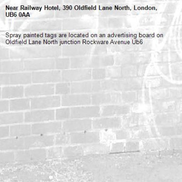 Spray painted tags are located on an advertising board on Oldfield Lane North junction Rockware Avenue Ub6 -Railway Hotel, 390 Oldfield Lane North, London, UB6 0AA