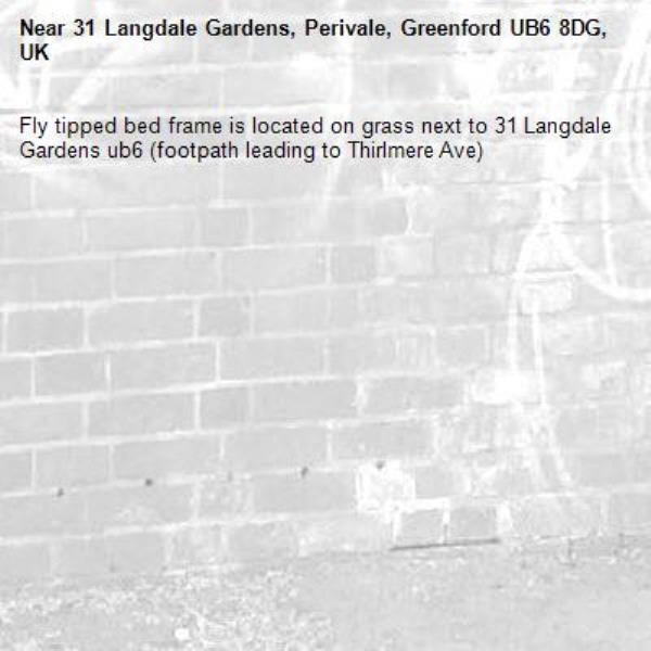 Fly tipped bed frame is located on grass next to 31 Langdale Gardens ub6 (footpath leading to Thirlmere Ave) -31 Langdale Gardens, Perivale, Greenford UB6 8DG, UK