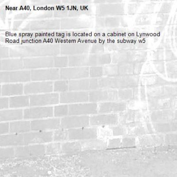 Blue spray painted tag is located on a cabinet on Lynwood Road junction A40 Western Avenue by the subway w5-A40, London W5 1JN, UK