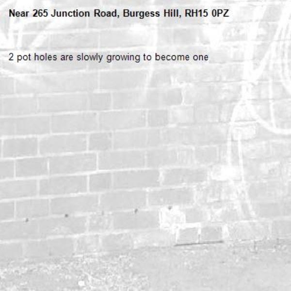 2 pot holes are slowly growing to become one-265 Junction Road, Burgess Hill, RH15 0PZ