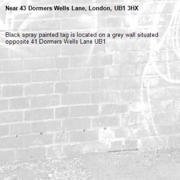 Black spray painted tag is located on a grey wall situated opposite 41 Dormers Wells Lane UB1-43 Dormers Wells Lane, London, UB1 3HX