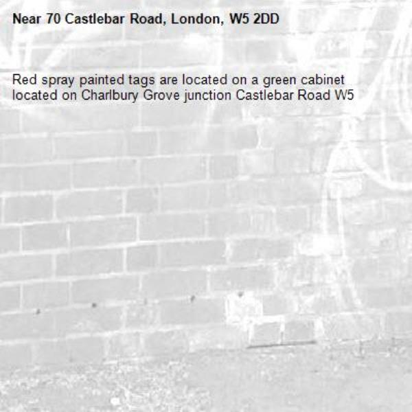 Red spray painted tags are located on a green cabinet located on Charlbury Grove junction Castlebar Road W5 -70 Castlebar Road, London, W5 2DD