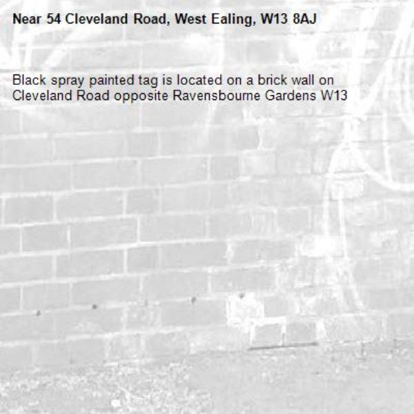 Black spray painted tag is located on a brick wall on Cleveland Road opposite Ravensbourne Gardens W13-54 Cleveland Road, West Ealing, W13 8AJ