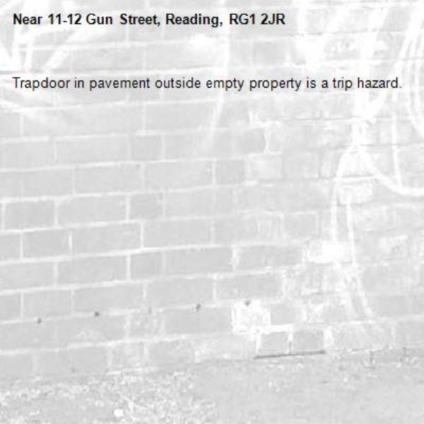 Trapdoor in pavement outside empty property is a trip hazard.-11-12 Gun Street, Reading, RG1 2JR