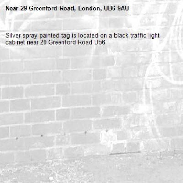 Silver spray painted tag is located on a black traffic light cabinet near 29 Greenford Road Ub6 -29 Greenford Road, London, UB6 9AU
