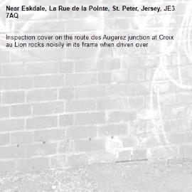 Inspection cover on the route des Augerez junction at Croix au Lion rocks noisily in its frame when driven over -Eskdale, La Rue de la Pointe, St. Peter, Jersey, JE3 7AQ