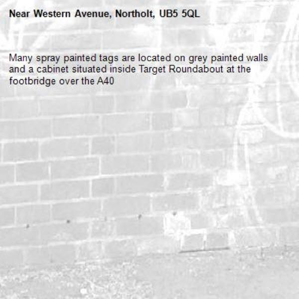 Many spray painted tags are located on grey painted walls and a cabinet situated inside Target Roundabout at the footbridge over the A40 -Western Avenue, Northolt, UB5 5QL