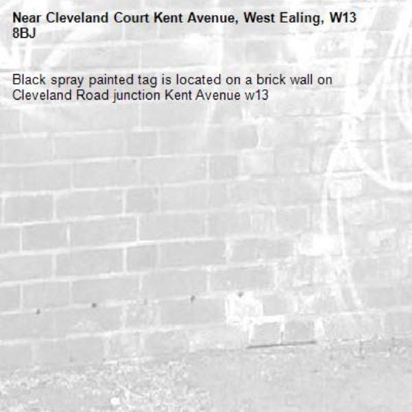 Black spray painted tag is located on a brick wall on Cleveland Road junction Kent Avenue w13-Cleveland Court Kent Avenue, West Ealing, W13 8BJ