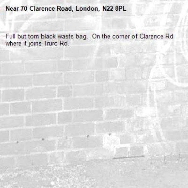 Full but torn black waste bag.  On the corner of Clarence Rd where it joins Truro Rd.  -70 Clarence Road, London, N22 8PL