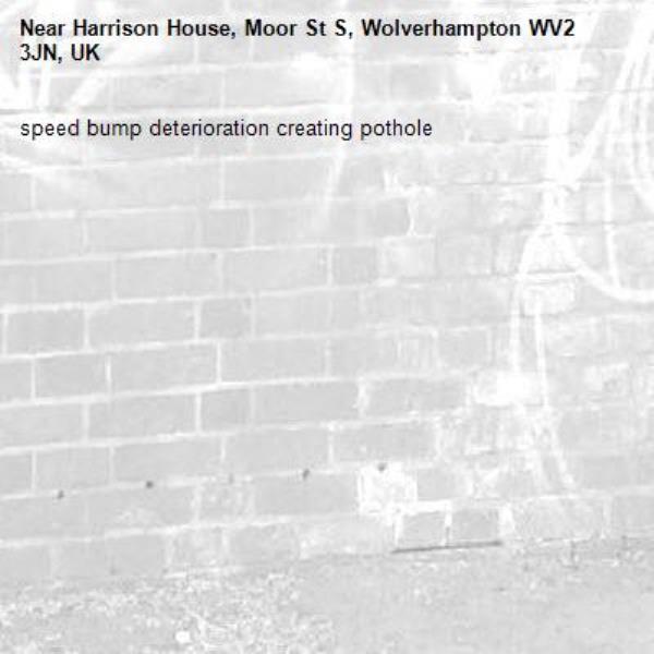 speed bump deterioration creating pothole-Harrison House, Moor St S, Wolverhampton WV2 3JN, UK