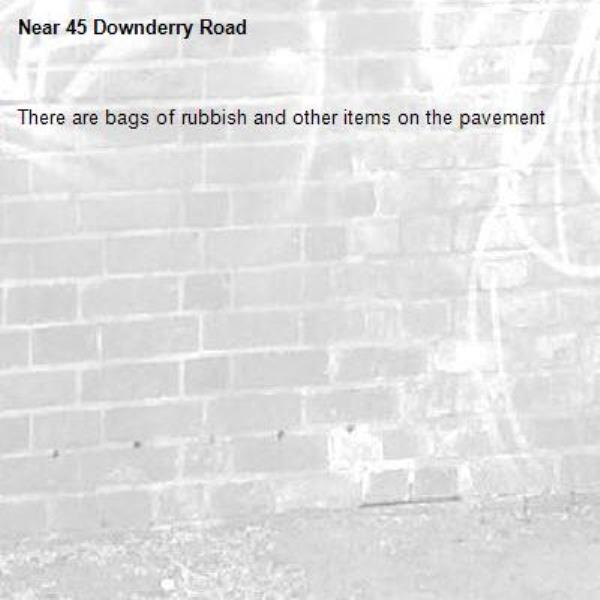 There are bags of rubbish and other items on the pavement-45 Downderry Road