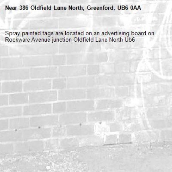 Spray painted tags are located on an advertising board on Rockware Avenue junction Oldfield Lane North Ub6 -386 Oldfield Lane North, Greenford, UB6 0AA
