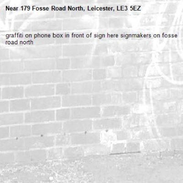 graffiti on phone box in front of sign here signmakers on fosse road north-179 Fosse Road North, Leicester, LE3 5EZ