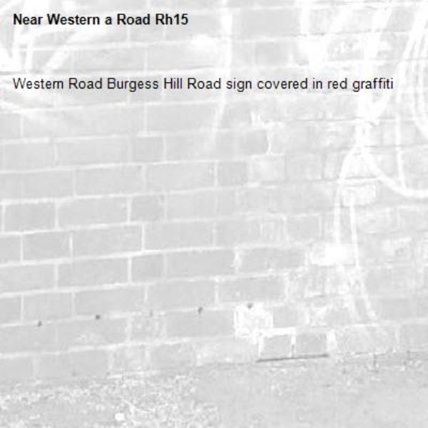 Western Road Burgess Hill Road sign covered in red graffiti -Western a Road Rh15