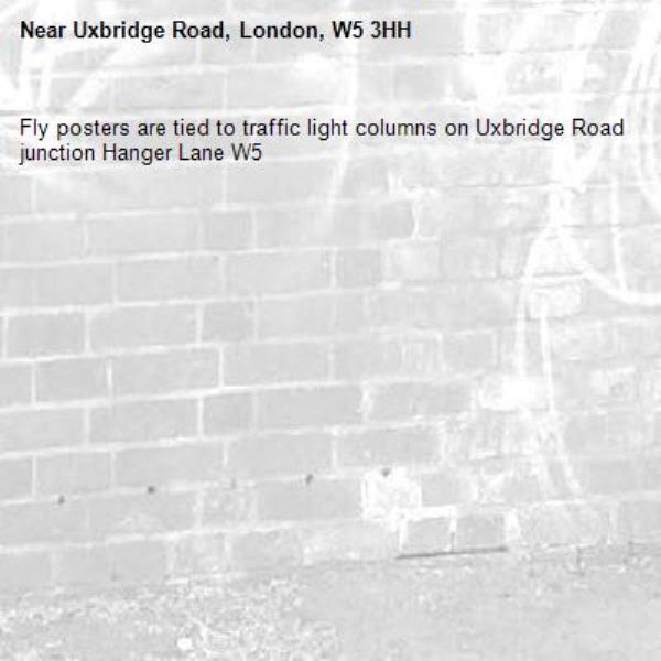Fly posters are tied to traffic light columns on Uxbridge Road junction Hanger Lane W5 -Uxbridge Road, London, W5 3HH
