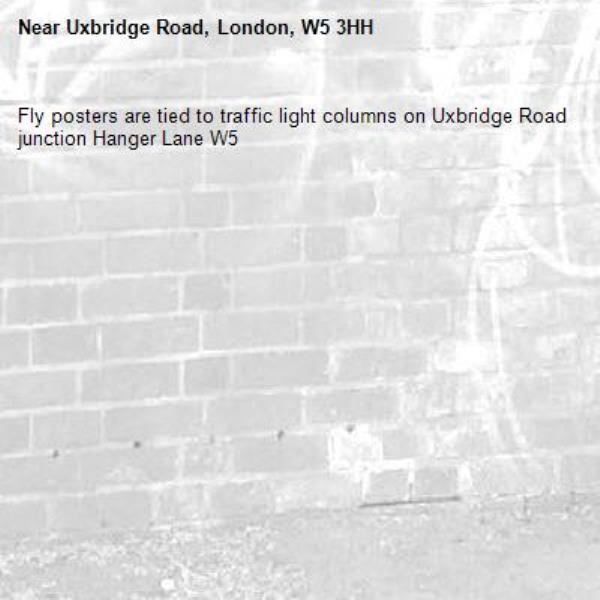 Fly posters are tied to traffic light columns on Uxbridge Road junction Hanger Lane W5 -Uxbridge Road, London, W5 3HH