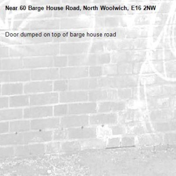 Door dumped on top of barge house road -60 Barge House Road, North Woolwich, E16 2NW