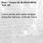 Loose pallets and waste dumped along the highway in Hawes Court. -7 Harpur St, Bedford MK40 1LA, UK