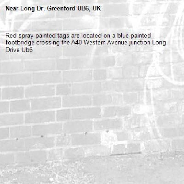Red spray painted tags are located on a blue painted footbridge crossing the A40 Western Avenue junction Long Drive Ub6 -Long Dr, Greenford UB6, UK
