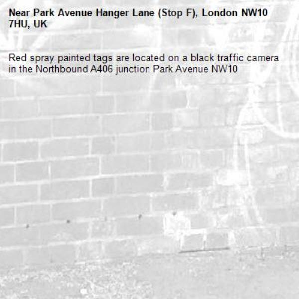 Red spray painted tags are located on a black traffic camera in the Northbound A406 junction Park Avenue NW10 -Park Avenue Hanger Lane (Stop F), London NW10 7HU, UK